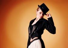 Beautiful young girl in a tuxedo stock photo