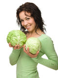 Beautiful young girl with two green cabbages Stock Photo