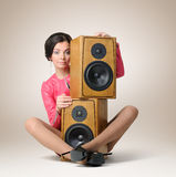 Beautiful young girl with two speakers Stock Photos