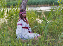 Beautiful young girl in Ukrainian embroidery dress. Stock Images