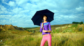 Beautiful young girl with an umbrella Royalty Free Stock Photos
