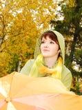 Beautiful young girl and umbrella. Stock Image