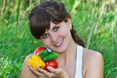 Beautiful young girl with the vegetables Stock Photos