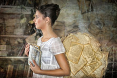 Beautiful young girl in a vintage dress. Beautiful young girl in a vintage dress with wings on her  back Royalty Free Stock Images