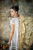 Beautiful young girl in a vintage dress. Royalty Free Stock Photography