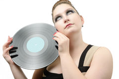 Beautiful young girl with a vinyl record Stock Photography