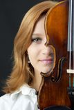 Beautiful young girl with violin Royalty Free Stock Image