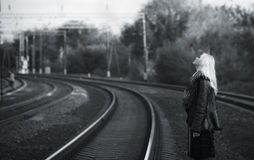 Beautiful young girl waiting for the train Royalty Free Stock Images