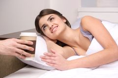Beautiful young girl waking in bed. Royalty Free Stock Photo
