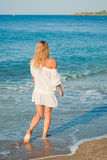Beautiful young girl walk on the beach Stock Photo