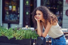 Beautiful young girl on a walk in the summer city royalty free stock photo