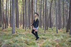 Beautiful young girl walking in the autumn forest. Royalty Free Stock Photos