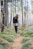 Beautiful young girl walking in the autumn forest. Stock Image