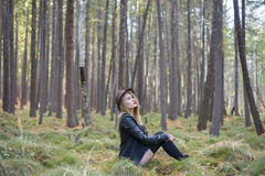 Beautiful young girl walking in the autumn forest. Royalty Free Stock Photo