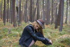 Beautiful young girl walking in the autumn forest. Royalty Free Stock Photography