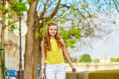 Beautiful young girl walking in Paris Royalty Free Stock Images