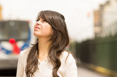 Beautiful young girl walking in the streets af Stock Photos