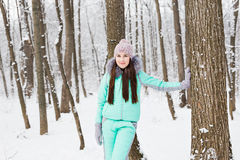 Beautiful young girl walking in winter forest Stock Images
