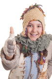 Beautiful young girl in warm winter clothes showing thumb up Royalty Free Stock Photos