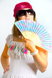 Beautiful young girl waving a fan Royalty Free Stock Images