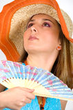 Beautiful young girl waving a fan Royalty Free Stock Photography