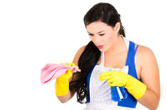 Beautiful young girl wearing apron and gloves Stock Photo