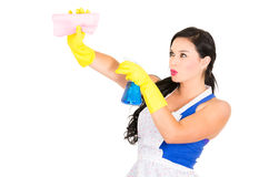 Beautiful young girl wearing apron and gloves Stock Photos
