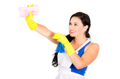 Beautiful young girl wearing apron and gloves Stock Photography