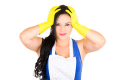 Beautiful young girl wearing apron and gloves Stock Images