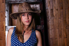 Beautiful young girl wearing cowboy hat Royalty Free Stock Photos