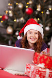 Beautiful young girl wearing a red Santa hat Stock Photography
