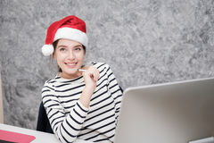 Beautiful young girl wearing a santa Christmas hat Royalty Free Stock Images