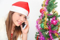Beautiful young girl wearing santa clause costume Stock Photo