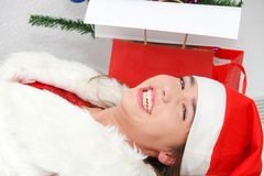 Beautiful young girl wearing santa clause costume Royalty Free Stock Photography