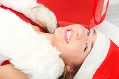 Beautiful young girl wearing santa clause costume Royalty Free Stock Photos