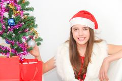 Beautiful young girl wearing santa clause costume Stock Photography