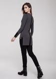 Beautiful young girl wearing shirt fashion on grey Stock Photography