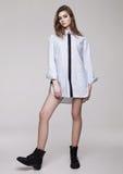 Beautiful young girl wearing shirt fashion on grey Stock Photos