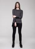 Beautiful young girl wearing shirt fashion on grey Royalty Free Stock Image