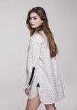 Beautiful young girl wearing shirt fashion on grey Stock Photo
