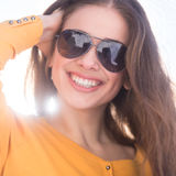 Beautiful young girl wearing sunglasses. Stock Photo