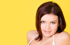 A beautiful young girl wearing swimsuit. On yellow Stock Photography