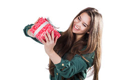 Beautiful young girl on a white background holding a box with a gift. Smiles. Royalty Free Stock Images