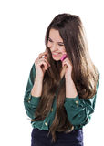 Beautiful young girl on a white background is a pink cell phone telefonom.Govorit. Smiles. Surprised. Stock Image