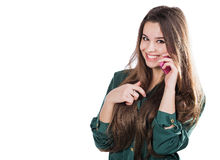 Beautiful young girl on a white background is a pink cell phone telefonom.Govorit. Smiles. Surprised. Royalty Free Stock Images