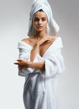 Beautiful Young girl in white bathrobe after spa. Stock Image