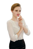 Beautiful young girl in a white blouse and black skirt Royalty Free Stock Photo