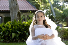 Beautiful young girl in white dress on bench Stock Photo