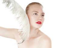 Beautiful young girl with a white feather. Stock Photos