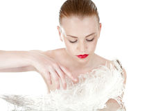 Beautiful young girl with a white feather. Spy beauty skin Stock Image